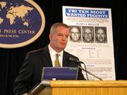 FBI Agent Richard Teahan at briefing