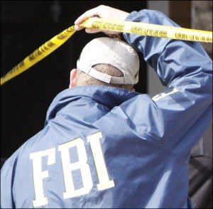 FBI Agent Outside Zazi's Colo. Apt/fbi photo