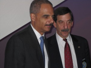 Holder on the left in Denver at the International Chiefs of Police Conference/ticklethewire.com photo