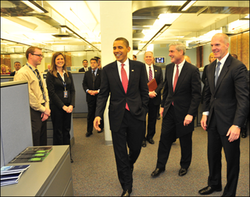 """President Obama visited the New York Joint Terrorism Task Force on Tuesday and said: """"Together, your success in thwarting terrorist attacks, the strong intelligence you gathered and the hard-nosed investigations you pursued, has proved to be a model for law enforcement officials across the country.""""  The President also commended FBI Director Robert Mueller, NYPD Commissioner Raymond Kelly and the head of the FBI New York office Joseph Demarest for putting together a """"team that is more integrated, more collaborative, and more effective than ever before."""" /FBI Photo"""
