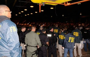About 500 FBI and other law enforcement officers gather get briefed before raids/fbi photo