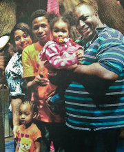 Eric Garner with his children, via National Action Network