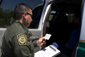 Border Patrol agents reads the Miranda rights to a Mexican national arrested for transporting drugs.