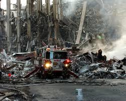 World Trade Center after the 9/11 attacks via Wikipedia.