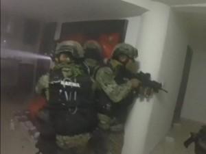 Agents conducting the raid, via Twitter.