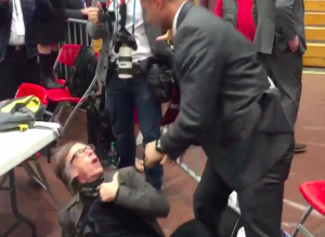 Time photographer is slammed to the ground by a Secret Service agent.