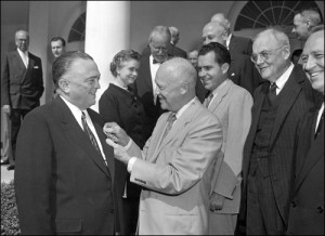 Director Hoover receives the National Security Medal from President Dwight Eisenhower on May 27, 1955, as then-Vice President Richard Nixon and others look on.  (FBI photo)