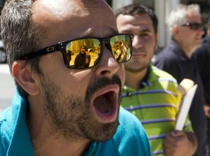 Donald Trump supporter yells at Muslim woman at a rally in Detroit. Photo by Steve Neavling.