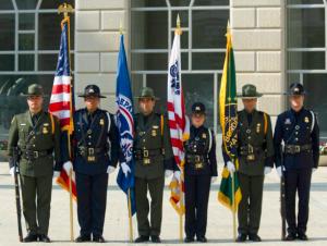 Trademark green uniforms worn by Border Patrol agents.