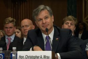 Christopher Wray testifies during his confirmation hearing to become the next FBI director.