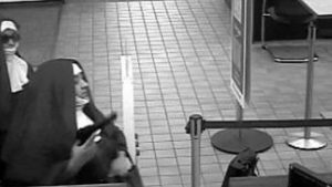 Two bank robbers dressed as nuns.