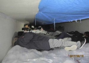 About 60 immigrants were found in this frigid trailer. Photo via CBP.